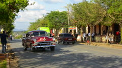 Viles Cuba with Main Square traffic on Main Street and busy small town Stock Footage
