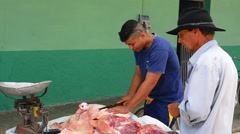 Australia town of Cuba man selling pig meat and cutting pork meat in outside Stock Footage