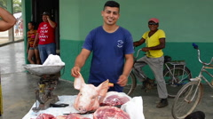 Australia town of Cuba man selling pig meat and cutting pork meat in outside - stock footage