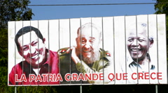 Cuba billboard of three heroes in Cuban life Hugo Chavez, Fidel Castro  Stock Footage