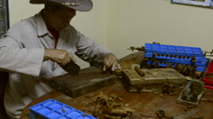 Pir del Rio area of Cuba with tobacco farmer rolling tobacco for cigars  Stock Footage