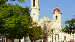 Cienfuegos Cuba Main Square and Parish Church twin tower cathedral with locals Stock Footage