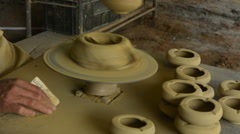 Trinidad Cuba clay pottery business with man working on pottery wheel to create Stock Footage