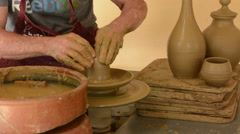 Trinidad Cuba clay pottery business with man working on pottery wheel to create - stock footage