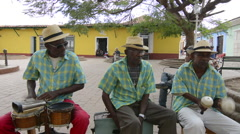 Trinidad Cuba old men playing music as band on street of second oldest city in Stock Footage