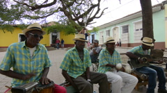 Trinidad Cuba old men playing music as band on street of second oldest city in - stock footage