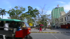 Santa Clara Cuba Main Square with locals walking and traffic around center of Stock Footage