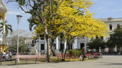 Santa Clara Cuba Main Square with locals and colorful trees  Stock Footage