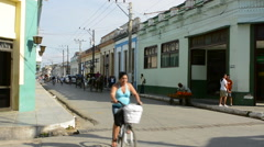 Cardes Cuba main street with traffic of locals in bikes and horse carriages - stock footage