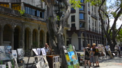 Hava Cuba Prado City Walk in center with art for sale and locals walking Stock Footage