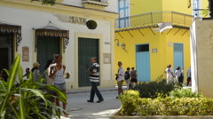Old Hava Cuba small peaceful plaza in city center yellow walls and corner and Stock Footage