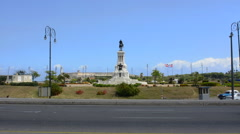 Hava Cuba walk statue with  traffic near center of town and Revolution Museum Stock Footage