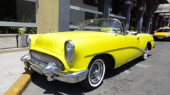 Hava Cuba Haba central colorful old classic 1950's car Buick yellow on display Stock Footage