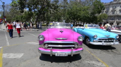 Hava Cuba Haba central colorful old classic 1950's cars on display near Capital Stock Footage