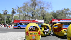 Hava Cuba Haba central colorful coco taxis and tourist bus near Capital for Stock Footage