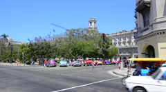 Hava Cuba traffic near Capital building with old classic autos from 1950's in Stock Footage
