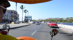 Hava Cuba traffic taken from a moving coco taxi in city rush Haba Stock Footage