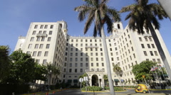 Hava Cuba world famous ciol Hotel front with palm trees and expensive hotel with Stock Footage