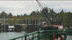 Ferry approaching dock on Bainbridge Island in pouring rain-POV Stock Footage