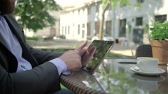 Close up, businessman browsing tablet. Outdoor. Steadicam shot. - stock footage