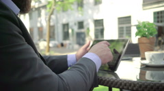 Close up, businessman browsing tablet. Outdoor. Steadicam shot. Stock Footage