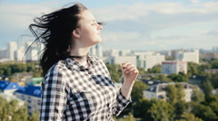 girl posing on the roof - stock footage