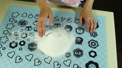 Cooking a pie. Woman doing deepening in the flour for the eggs. Slow motion. HD - stock footage