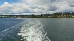View looking aft ferry wake departing Bainbridge Island Stock Footage