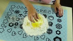 Cooking a pie. The woman mixing flour, egg, water and butter. Slow motion. HD - stock footage
