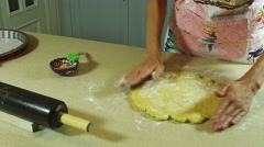 Cooking a pie. The woman rolling the dough with a rolling pin. Slow motion. HD Stock Footage