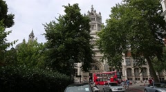 Victoria and Albert Museum with red bus passing Stock Footage
