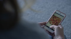 OTS shot of female using Instagram on an Iphone, in morning light. Stock Footage