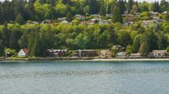 POV- Ferry passing houses tree on Bainbridge Island shoreline. Stock Footage