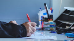 A man working with documents in a mail car Stock Footage