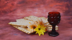 Passover background. wine and matzoh jewish holiday bread over wooden board Stock Footage