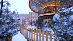 Workers clean snow near carrousel on New year and Christmas fair on Red Square Stock Footage