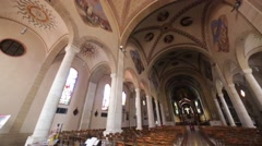 In italy turbigo inside  church religion building the altar chair desk colora Stock Footage