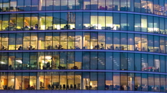 Glass office exterior, view of office workers at work, London, UK Stock Footage
