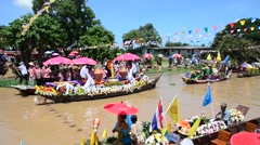 Thai people join lent candle festival for Asalha Puja and Buddhist Lent Day Stock Footage