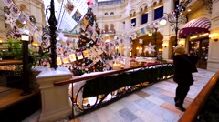 View of high Christmas tree brightly decorated in Moscow GUM, big mall Stock Footage