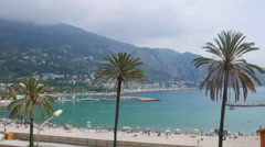 Menton city beach at summer day Stock Footage