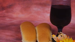 Lit Shabbath candles with uncovered challah bread Stock Footage