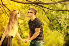 Couple in park share a kiss. Stock Photos