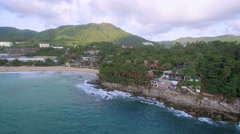Luxury Villas and Resort on Rocky Headland in Phuket Pullback Aerial Shot - stock footage