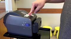 Motion of man pressing button for taking number inside lifelabs medicial center Stock Footage