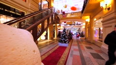 Walking in GUM, huge shopping mall in Moscow. Fashion stores and christmas trees Stock Footage