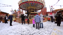 Carrousels in the form of horses, elephants, carriages, and etc . Christmas fair Stock Footage