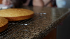 White Birthday Cake Cooling on Rack Made by Child Panning 10bit, 4K Stock Footage