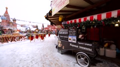 Christmas fair on the Red Square. Food stores, attractions, people, decorations Stock Footage