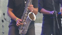 Expressive man playing the saxophone - stock footage